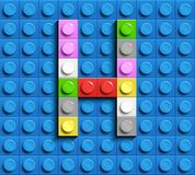 Colorful letters H of alphabet from building lego bricks on blue lego brick background. blue lego background. 3d letters C. Realis. Tic letters. 3D design Royalty Free Stock Photography