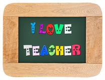 Colorful letters with i love teacher. With wood frame isolated on white background royalty free stock photography