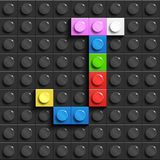 Colorful letters J of alphabet from building lego bricks on black lego brick background. lego background. 3d letters. 3D design Royalty Free Stock Photo