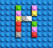 Colorful letters K of alphabet from building lego bricks on blue lego brick background. blue lego background. 3d letters C. Realis. Tic letters. 3D design Royalty Free Stock Photo