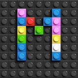 Colorful letters M of alphabet from building lego bricks on black lego brick background. lego background. 3d letters. 3D design Royalty Free Stock Image