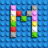 Colorful letters M of alphabet from building lego bricks on blue lego brick background. blue lego background. 3d letters C. Realis. Tic letters. 3D design stock illustration