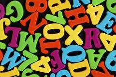 Colorful letters. Colorful numbers and letters on black background royalty free stock photography