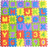 Colorful letters numbers toys. Abstract background Stock Photography