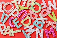 Colorful Letters with Patterns. Random colorful uppercase letters with beautiful patterns on red background Stock Images