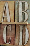 Colorful letters on rustic blocks of wood Stock Photo