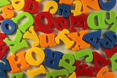 Colorful letters. Scattered on the table Stock Photography