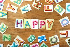 Colorful letters spelled as happy Stock Photos
