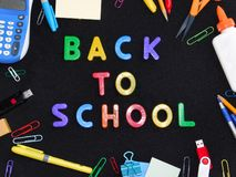 Back to School on black background framed by school supplies stock photos