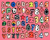 Colorful letters, star and heart stickers on a pink background.  Stock Photography