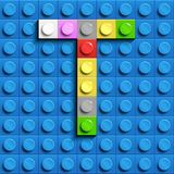 Colorful letters T of alphabet from building lego bricks on blue lego brick background. blue lego background. 3d letters C. Realis. Tic letters. 3D design Stock Photography