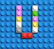Colorful letters V of alphabet from building lego bricks on blue lego brick background. blue lego background. 3d letters C. Realis. Tic letters. 3D design Stock Photos