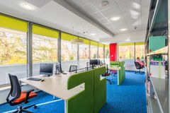 Colorful library interior with desks royalty free stock images