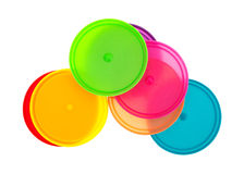 Colorful lids on a white background. Royalty Free Stock Photography