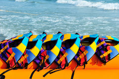 Colorful life jackets on banaboat Stock Image