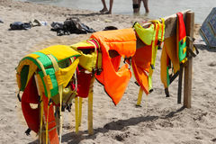 Colorful life jackets save your life. Safety in water. Rescue service on the beach. Injuries to water attractions. be Stock Image