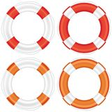 Colorful lifebuoy set with stripes and rope. Royalty Free Stock Photography