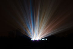 Colorful light beam from movie projector. In open-air cinema on black background Royalty Free Stock Image