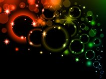 Colorful light bubbles Background. Neon rainbow bokeh effect. Dark background with Glowing sparkling circles and rings Royalty Free Stock Photo