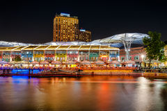 Colorful light building at night in Clarke Quay, located within the Singapore River Area. Stock Image
