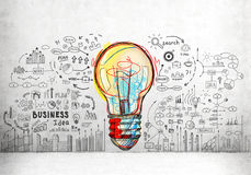 Colorful light bulb and business icons Royalty Free Stock Photography