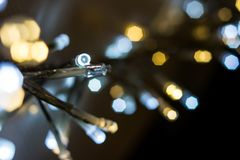 Colorful light bulbs on a bokeh background royalty free stock photos