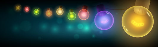 Colorful light bulbs hanging in the night. Old style colorful warm bulbs hanging on the bokeh night background. Vector banner illustration. Copy space. Ideal Stock Images