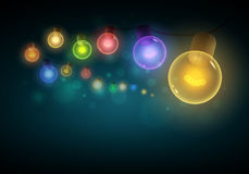 Colorful light bulbs hanging in the night. Royalty Free Stock Photography
