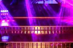 Colorful light on an empty stage. Pink lights and smoke in club for party Royalty Free Stock Image