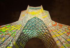 Colorful Light Illumination on Azadi Monument of Tehran. TEHRAN, IRAN - OCTOBER 4, 2015: Light Concert entitled Gate of Words projected on Azadi Monument. The stock photos
