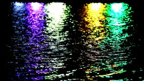 Colorful light reflect on the water at night stock video footage