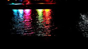 Colorful light reflect on the water at night. Video shift motion 1920*1080 stock video