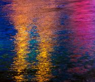Colorful light reflection on the water Stock Images
