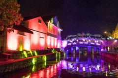 Colorful light show on houses wall royalty free stock image
