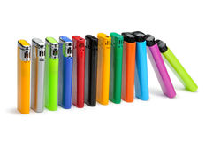 Colorful lighters on white background Stock Photos
