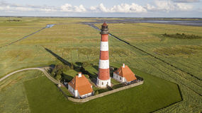 Colorful lighthouse at Westerhever, Germany stock photos