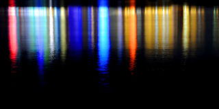 Colorful lighting reflection in water Stock Images