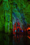 Colorful lighting on a stalactite column royalty free stock photography