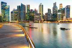 Colorful lights architecture business building and financial district in sunset time. At Singapore City royalty free stock image