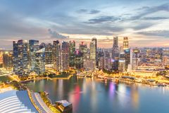 Colorful lights architecture business building and financial district in sunset time. At Singapore City stock photos