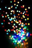 Colorful lights fly. Ing upwards on black background royalty free stock photography