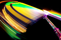 Colorful Lights at Funfair. The colorful lighttrails of a fast spinning attraction on a funfair royalty free stock images