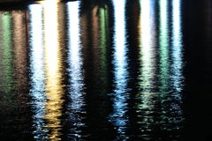 Colorful lights reflecting on sea surface Royalty Free Stock Photography