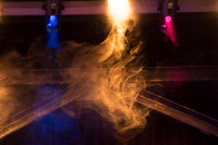 Colorful lights with smoke in club, concert. Equipment Stock Photos