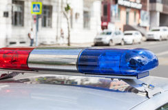 Colorful lights on top of a russian police vehicle Stock Photography