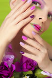 Colorful lilac manicure and lips. Royalty Free Stock Images