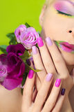 Colorful lilac manicure and lips. Stock Photos