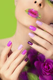 Colorful lilac manicure and lips. Stock Images