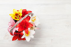 Colorful lily flowers basket Royalty Free Stock Photos