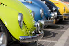 Colorful line of classic cars Royalty Free Stock Photos